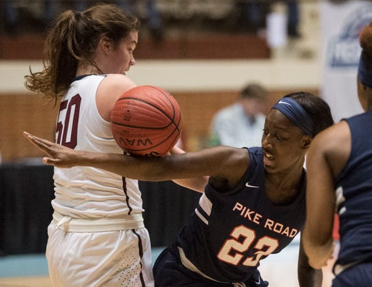 Montgomery Academy's Margaret Head (50) and Pike Road's Tynia Rogers (23) fight for a loose ball during the Class 3A southeast regional championship at Garrett Coliseum in Montgomery, Ala., on Wednesday, Feb. 20, 2019. Montgomery Academy leads Pike Road 21-44 at halftime.