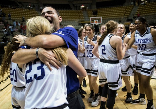 Prattville Christian's Kaitlyn Reyes (23) and coach Jason Roberson celebrate after winning the Class 3A southwest regional championship at Dunn-Oliver Acadome in Montgomery, Ala., on Wednesday, Feb. 20, 2019. Prattville Christian defeated T.R. Miller 41-35.