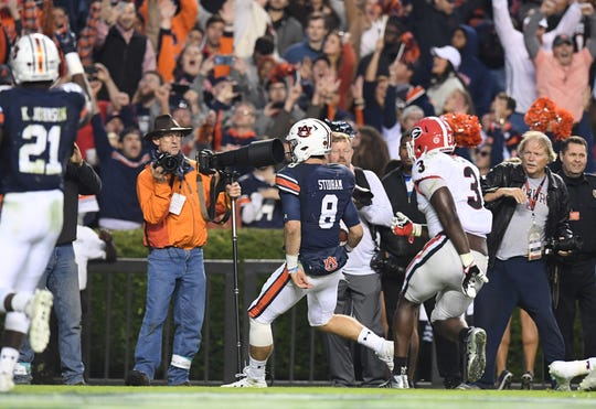 Auburn quarterback Jarrett Stidham (8) carries for a touchdown against Georgia during the Deep South's Oldest Rivalry on Nov. 11, 2017, in Auburn, Ala.