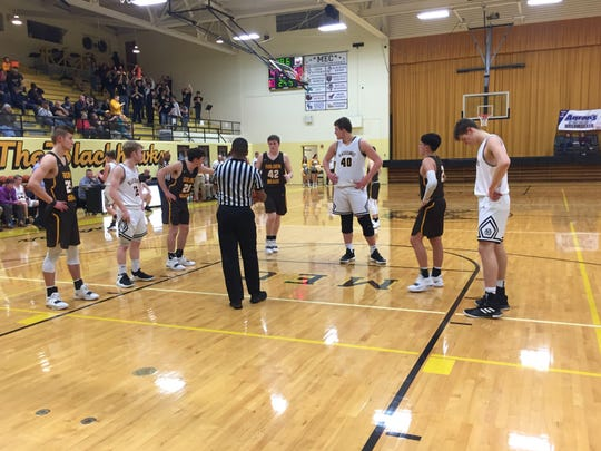 Cowan's Riley Duncan, at the free-throw line, presents a huge mismatch inside with his 6-foot-10 frame.