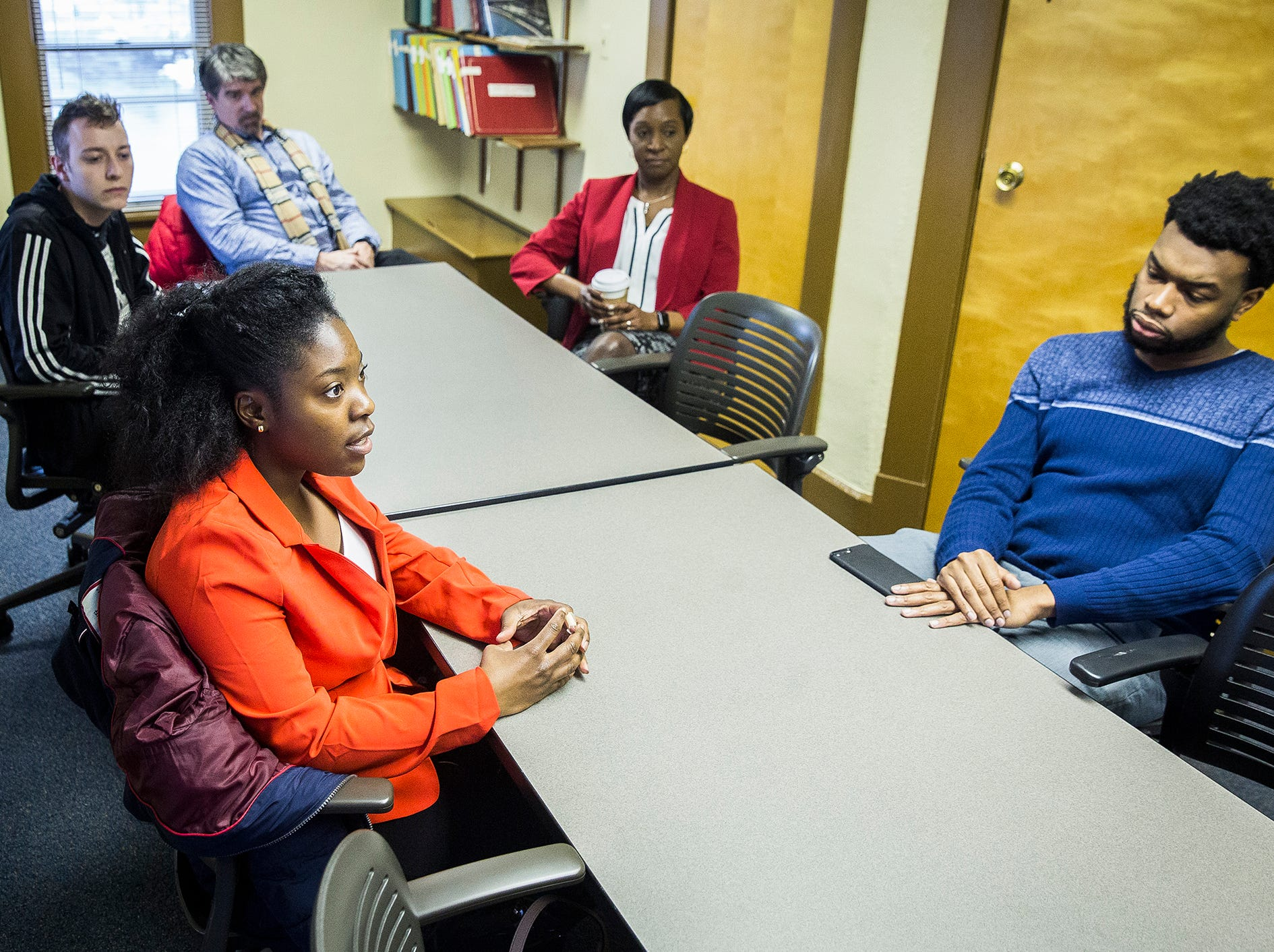 Ball State students Marquice Gee and Ren Walstrom (left) talk to The Star Press during an interview at the  Multicultural Center on McKinley Avenue Wednesday afternoon.  Director Bobby Steele, right, and Student Affairs VP Ro-Anne Royer Engle and spokesman Marc Ransford also were in attendance.