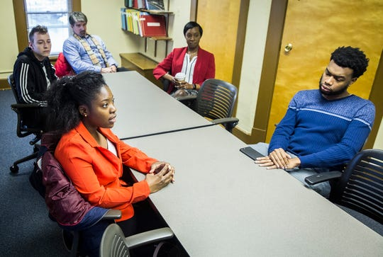 Ball State students Marquise Gee and Ren Walstrom (left) talk during an interview also attended by Multicultural Center Director Bobby Steele (right), VP of Student Affairs Ro-Anne Royer Engle, and university spokesman Marc Ransford.