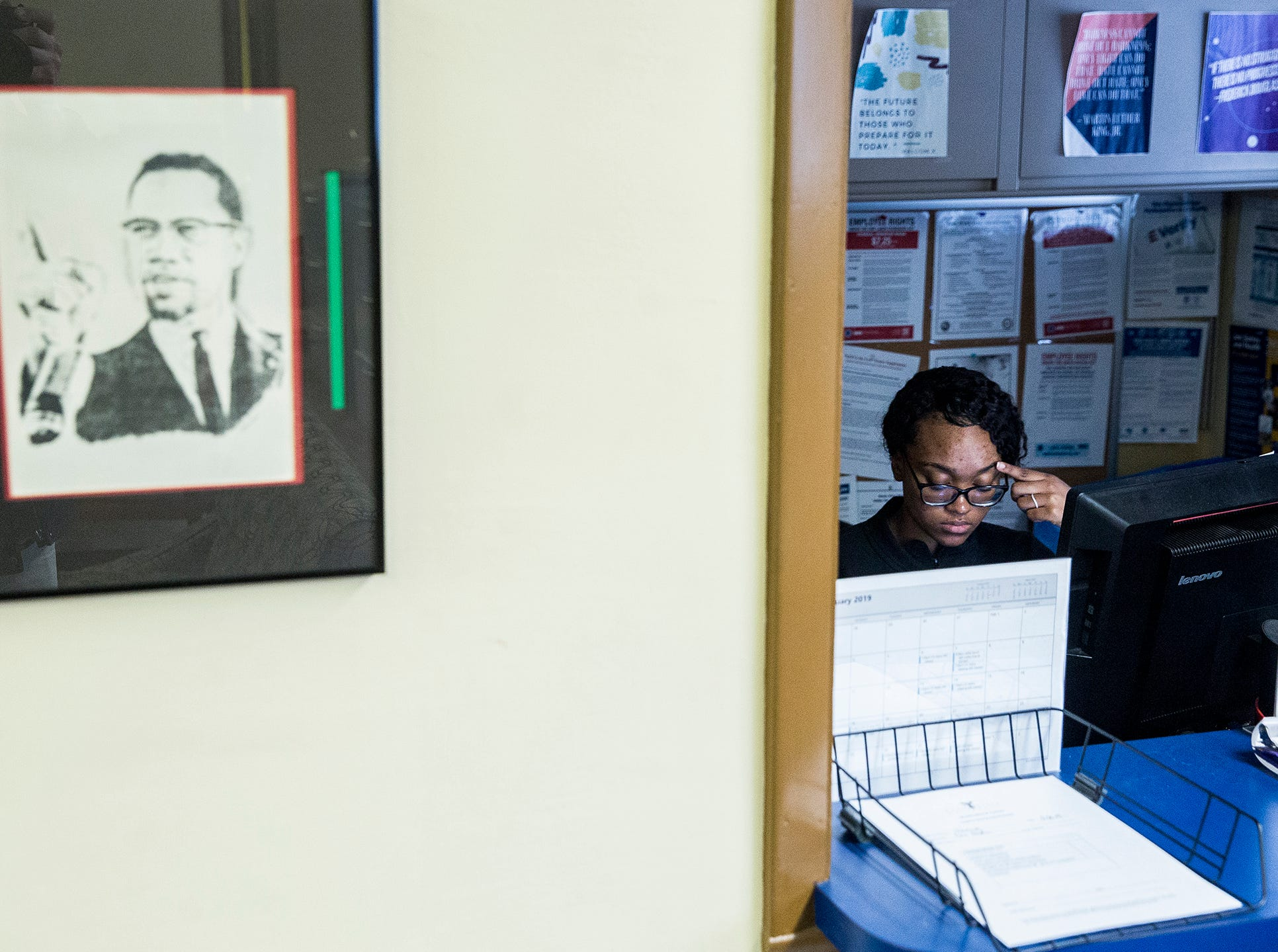 A receptionist works at the front desk at Ball State's Multicultural Center on McKinley Avenue Wednesday afternoon.