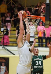 Cowan's Riley Duncan goes up for a dunk during a game against Randolph Southern this season.