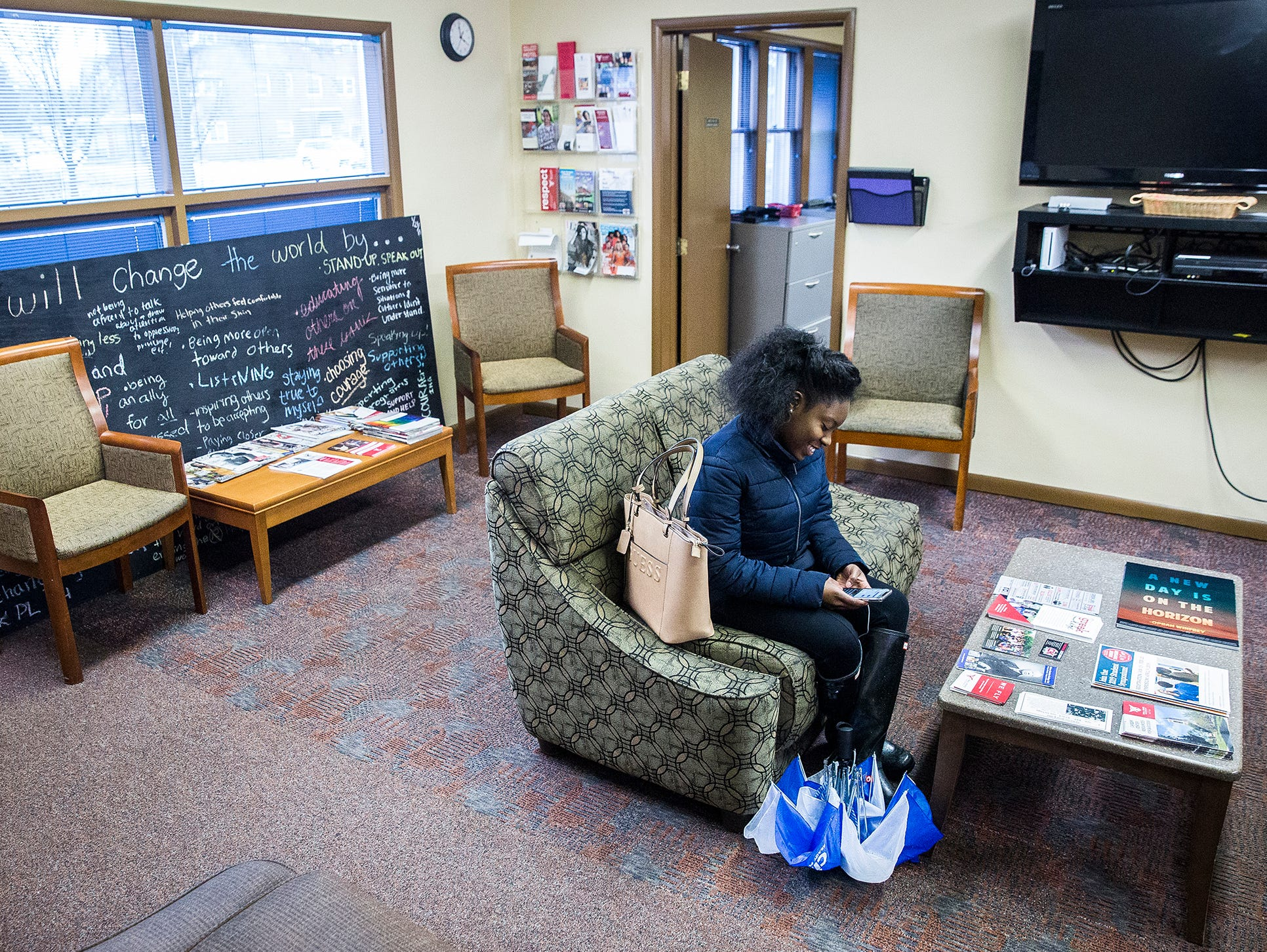 A student texts a message in Ball State's Multicultural Center on McKinley Avenue Wednesday afternoon.