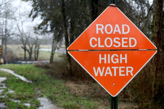 A road closed road sign was posted at the County Farm Road slab bridge on Wednesday, Feb. 20, 2019.
