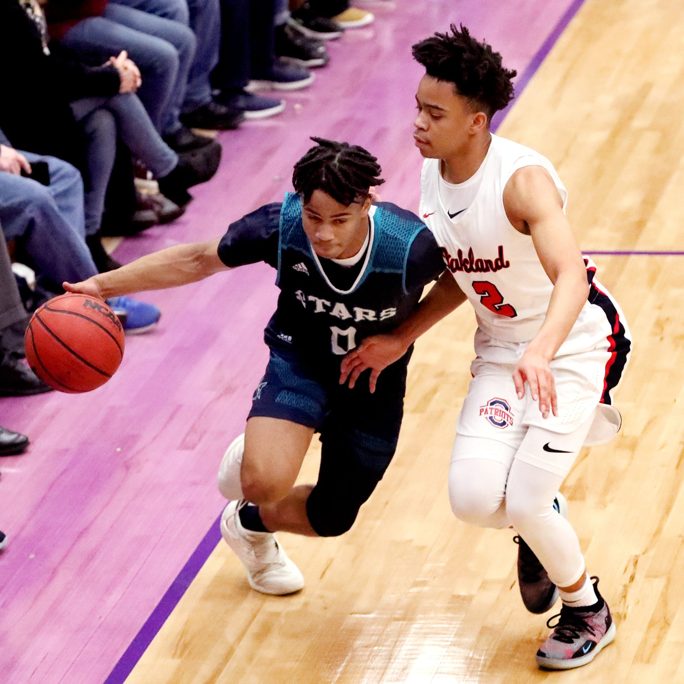 Siegel's Zion Swader (0) brings the ball up court as Oakland's Ray Tyler (2) guards him during the District boys 7-AAA Championship game, on Tuesday, Feb. 19, 2019.