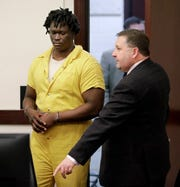 Emanuel Samson, left, enters the courtroom for a hearing Wednesday, Feb. 20, 2019, in Nashville, Tenn. Samson is accused of fatally shooting a woman and wounding six other people at a Tennessee church in September 2017. (AP Photo/Mark Humphrey)