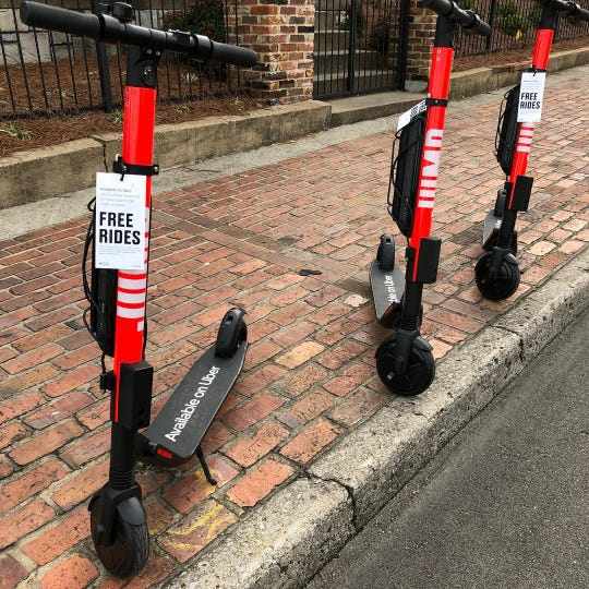 Uber JUMP electric scooters in front of the Germantown Depot in Nashville, Feb. 19, 2019.