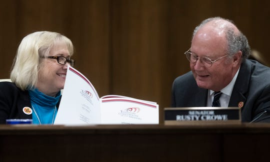 Tennessee State Senators Becky Duncan Massey, left and Rusty Crowe react to information in the Comptroller's report on UT Knoxville's Sex Week during a hearing before the General Assembly's Senate Education Committee, Wednesday, February 20, 2019.