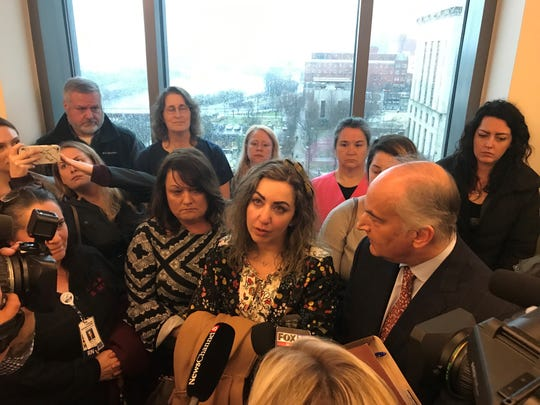 RaDonda Vaught, center, speaks to reporters after her arraignment Wednesday, Feb. 20, 2019. She is surrounded by nurses who attended her court hearing to support her defense.