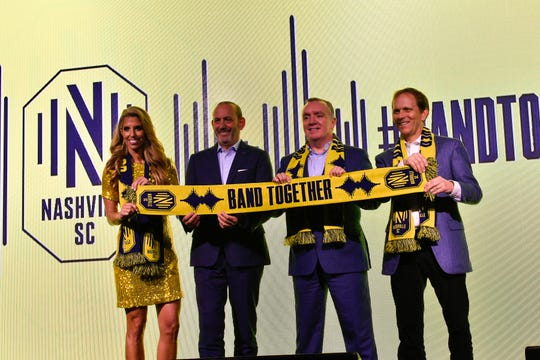 From left, Sara Walsh, MLS commissioner Don Garber, Nashville SC CEO Ian Ayre and owner John Ingram pose for a picture before the Nashville MLS franchise announcement for the team's name and logo at Marathon Music Works Wednesday, Feb. 20, 2019 in Nashville, Tenn.