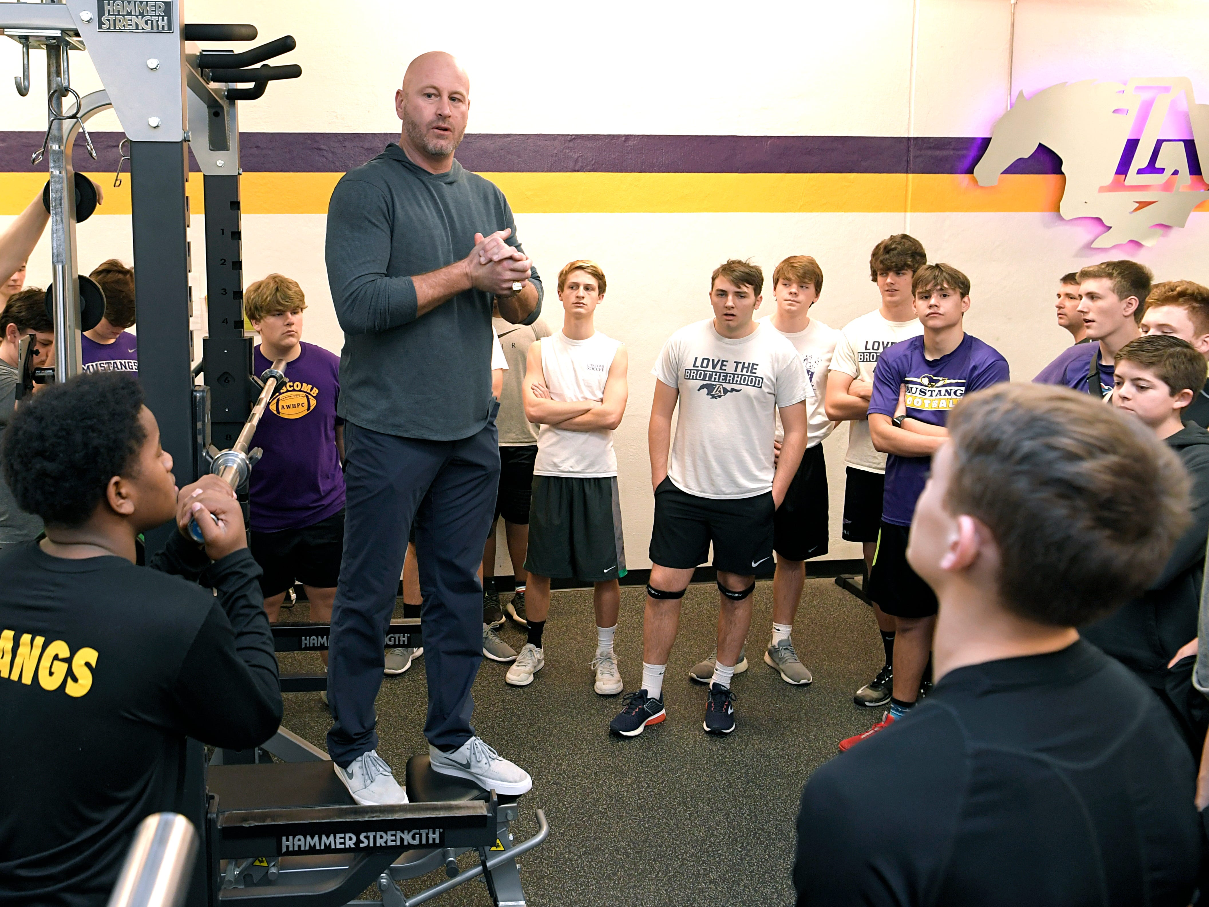 Former NFL player and Lipscomb Academy football coach Trent Dilfer talks to his team after a morning weight training session at  Lipscomb Academy in Nashville on Wednesday, Feb. 20, 2019.