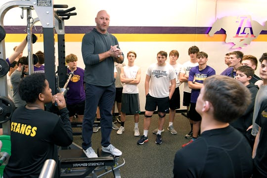 Former NFL quarterback and Lipscomb Academy football coach Trent Dilfer talks to his team after a morning weight training session Wednesday.