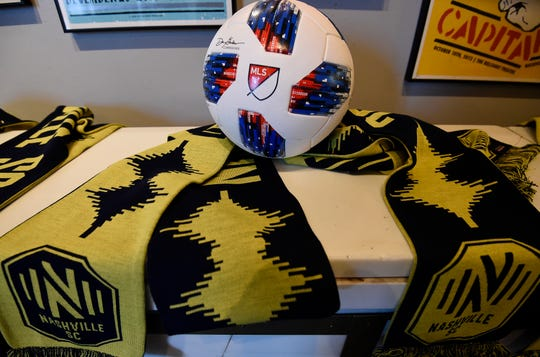Scarves rest on a shelf with the Nashville MLS franchise new logo and team name at Marathon Music Works Wednesday, Feb. 20, 2019 in Nashville, Tenn.