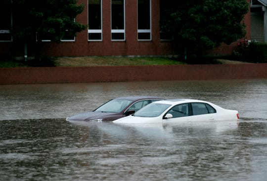 Cars sit in the flooded parking lot of the Brentwood Family YMCA on Concord Road in Brentwood Wednesday, Feb. 20, 2019, after days of rain have hit Middle Tennessee.