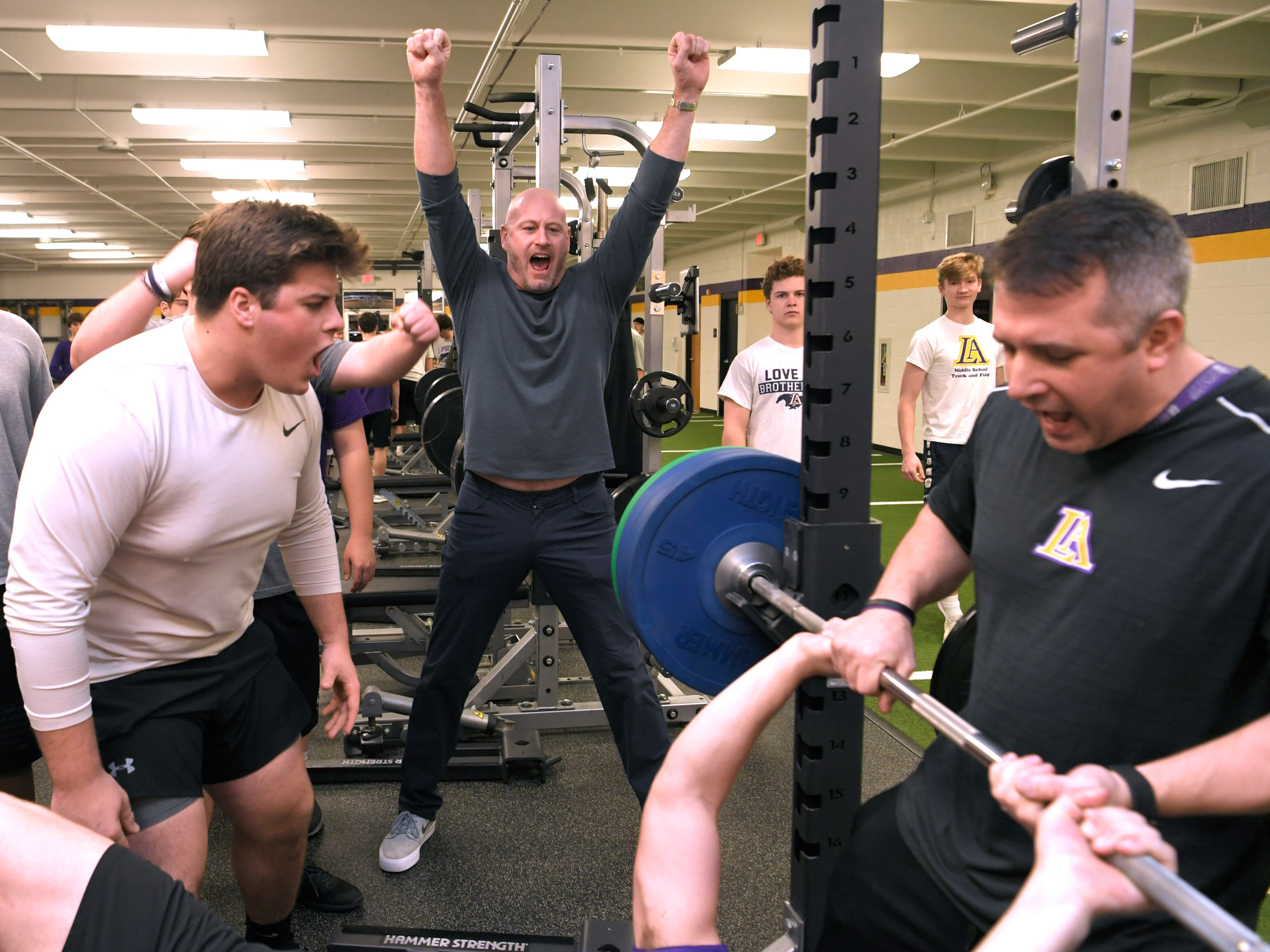 Former NFL player and Lipscomb Academy football coach Trent Dilfer cheers on his players during a morning weight training session at Lipscomb Academy in Nashville on Wednesday, Feb. 20, 2019.
