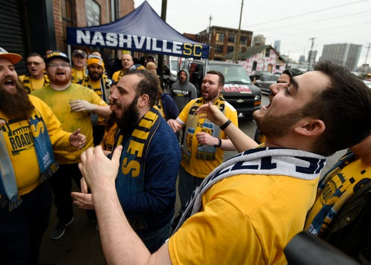 Angelo Todaro of the Roadies, the Nashville SC fan club, cheers outside before the Nashville MLS franchise announcement for the team's name and logo at Marathon Music Works Wednesday, Feb. 20, 2019 in Nashville, Tenn.