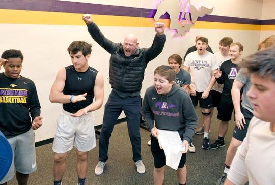 Former NFL quarterback and new Lipscomb Academy football coach Trent Dilfer, middle, cheers on his players during a morning weight training session Wednesday.