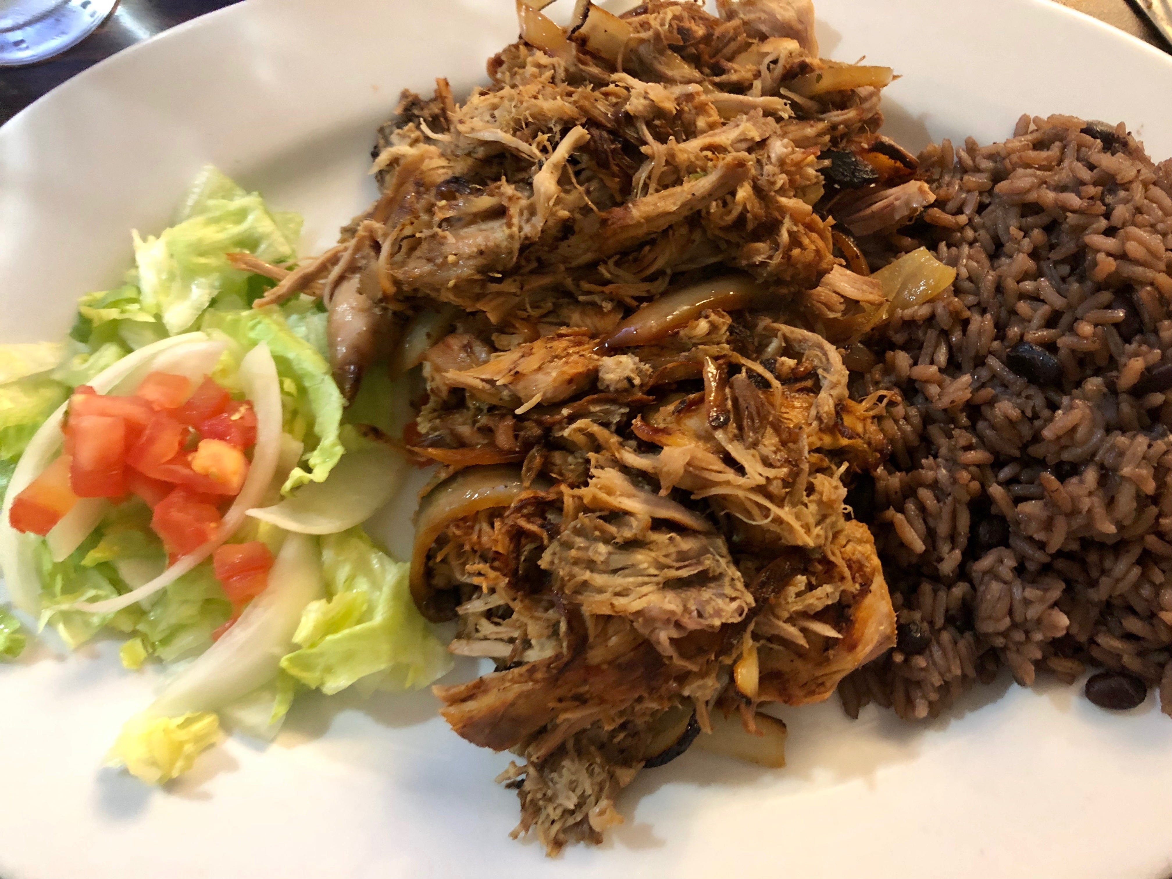 Cuban roasted pork laced with grilled onions at El Meson Latin Cuisine Bar & Grill in Bonita Springs.