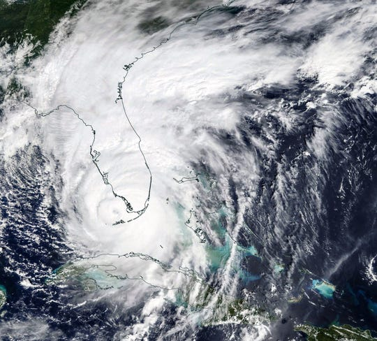 NASA satellite image taken Sept. 10, 2017, shows Hurricane Irma about to make landfall in Southwest Florida.