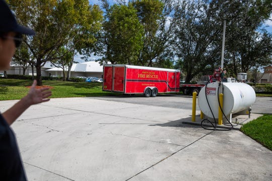"""Heather Mazurkiewicz motions to equipment she says there is not room to store properly inside in the current location of the North Collier Fire Control and Rescue District in North Naples on Wednesday, Feb. 20, 2019. """"It's left to the elements,"""" Mazurkiewicz said. """"It's one reason we need a new space."""""""