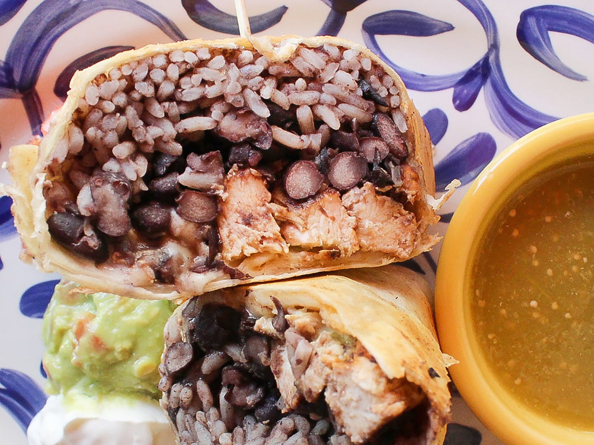 The Dorado-style chicken burrito at Rocco's Tacos features yellow rice, black beans, cotija and Chihuahua cheeses, hot sauce, guacamole and pico de gallo griddled in a flour tortilla and served with verde sauce.