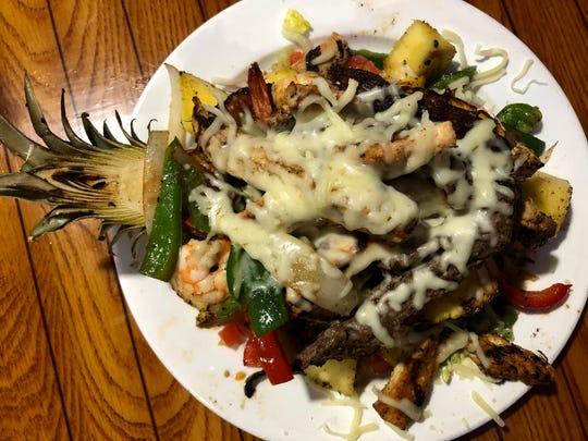 The Hawaiian is a fajita-stuffed grilled pineapple boat at El Meson Latin Cuisine Bar & Grill in Bonita Springs.