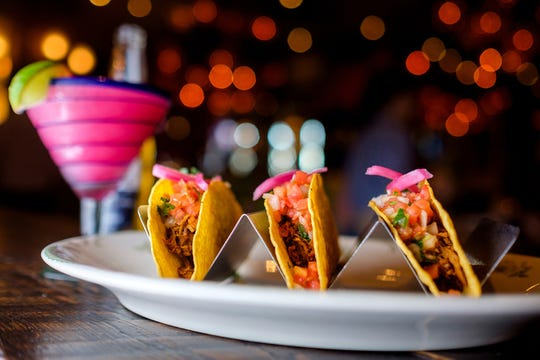 The Tradicional tacos at Rocco's Tacos & Tequila Bar feature carnitas-style pork, cilantro, onion and salsa brava.