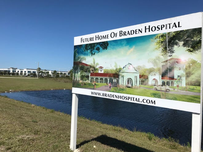 The site of the planned 25-bed Braden Hospital in Ave Maria off Oil Well Road. In the background is a manufacturing plant owned by Arthrex, the North Naples-based medical device company.