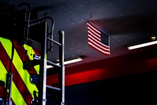 An American flag hangs in the North Collier Fire Control and Rescue District in North Naples on Wednesday, Feb. 20, 2019. The station has plans to relocate to a new station.