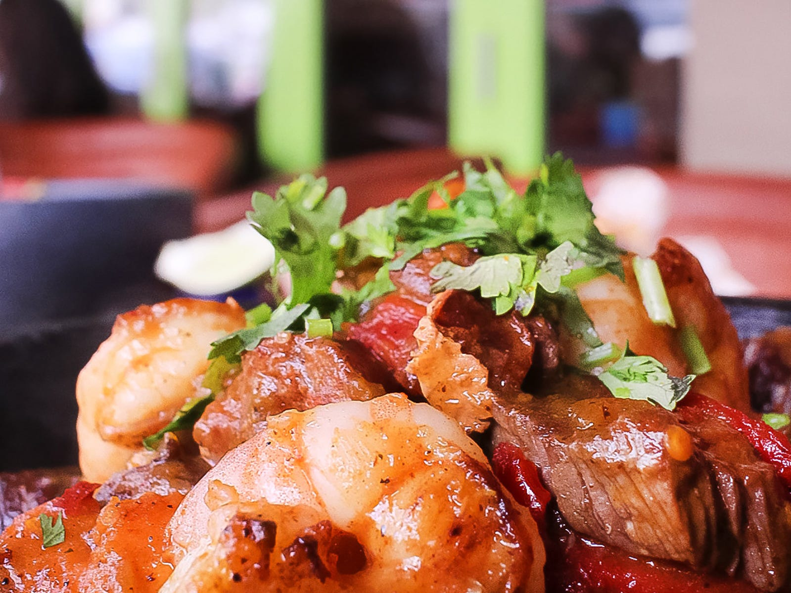 Surf & Turf Molcajetes at Rocco's Tacos & Tequila Bar features marinated grilled steak, chorizo, sweet potatoes, chicken and shrimp in a roasted garlic verde sauce.