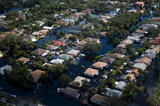 Aerial view of flooded Quinn Street in Bonita Springs on Saturday, Sept. 16, 2017, six days after Hurricane Irma.