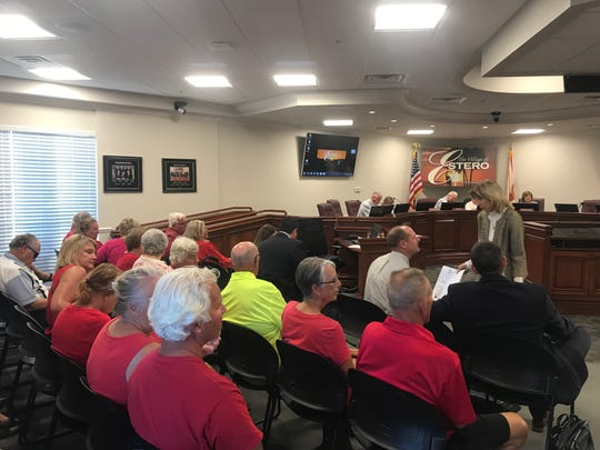 Residents of Island Club and Corkscrew Woodlands wear red in protest of the Estero Crossing project at a public hearing before the Estero Planning and Zoning Board on Tuesday, Feb. 19, 2019.