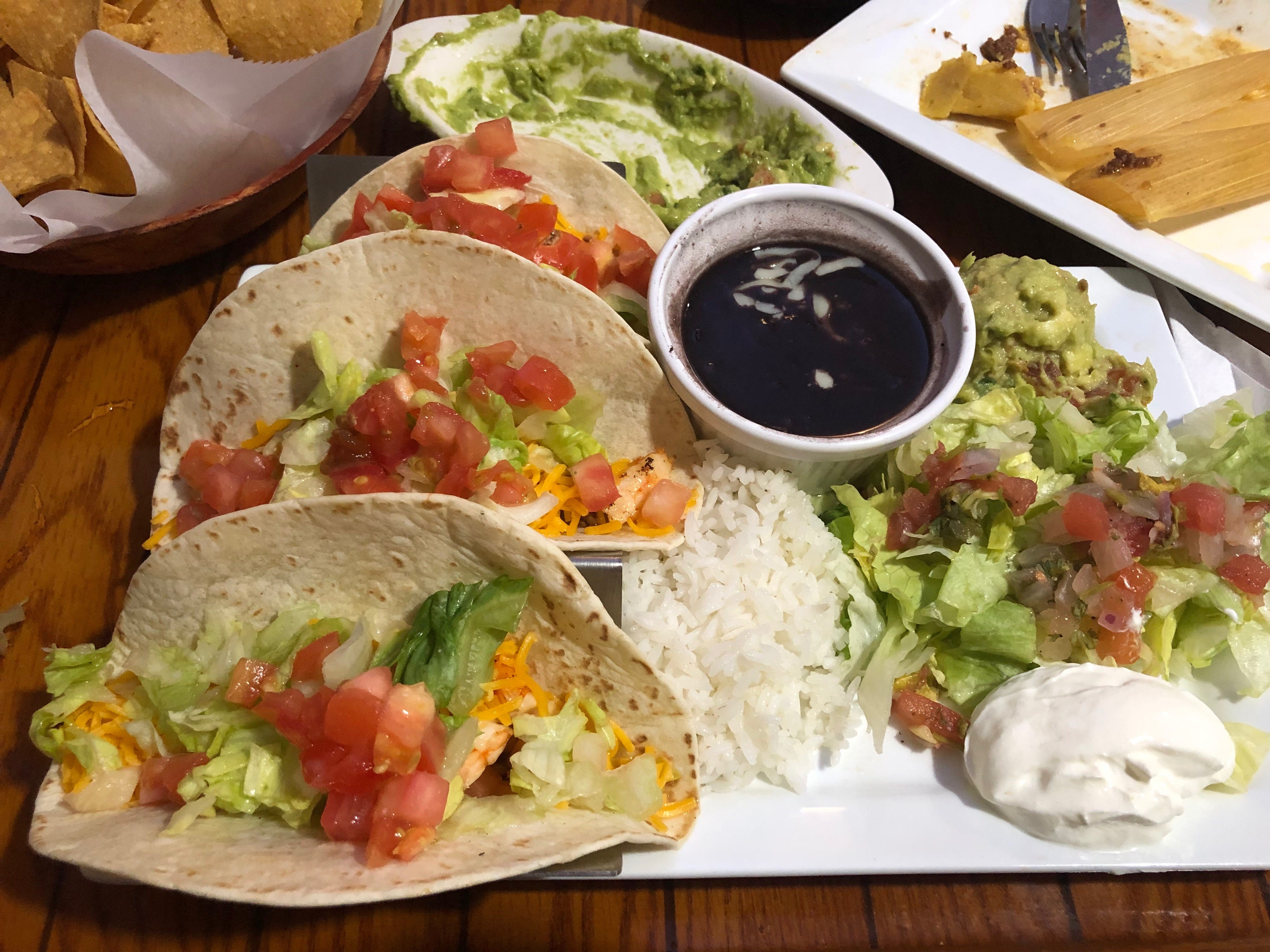 Shrimp tacos come with buttery black beans, rice and all the fixings at El Meson Latin Cuisine Bar & Grill in Bonita Springs.