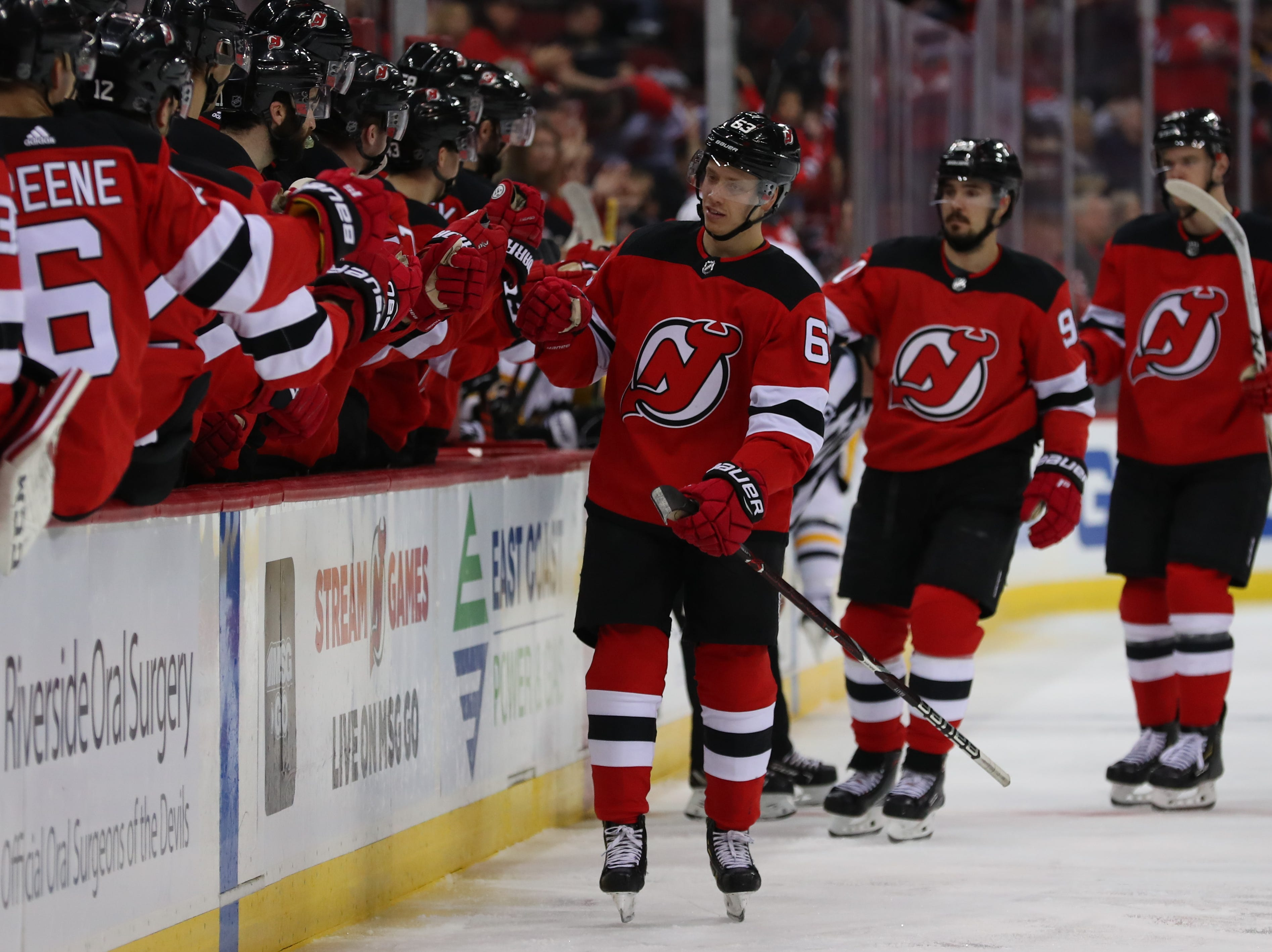 Feb 19, 2019; Newark, NJ, USA; New Jersey Devils left wing Jesper Bratt (63) celebrates his goal during the first period of their game against the Pittsburgh Penguins at Prudential Center. Mandatory Credit: Ed Mulholland-USA TODAY Sports