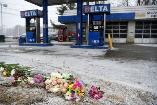 A makeshift memorial of flowers was laid on the ground at the Delta gas station on Route 23 north in Wayne on the day after a fatal car crash there last February.