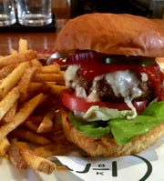 The CC Burger is made with vermont cheddar and applewood-smoked bacon.