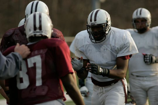 In this 2006 photo, Don Bosco offensive lineman Sam Griffin lines up during practice.