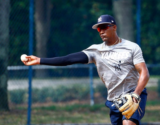 New York Yankees third baseman Miguel Andujar (41) throws to first base during spring training at George M. Steinbrenner Field.