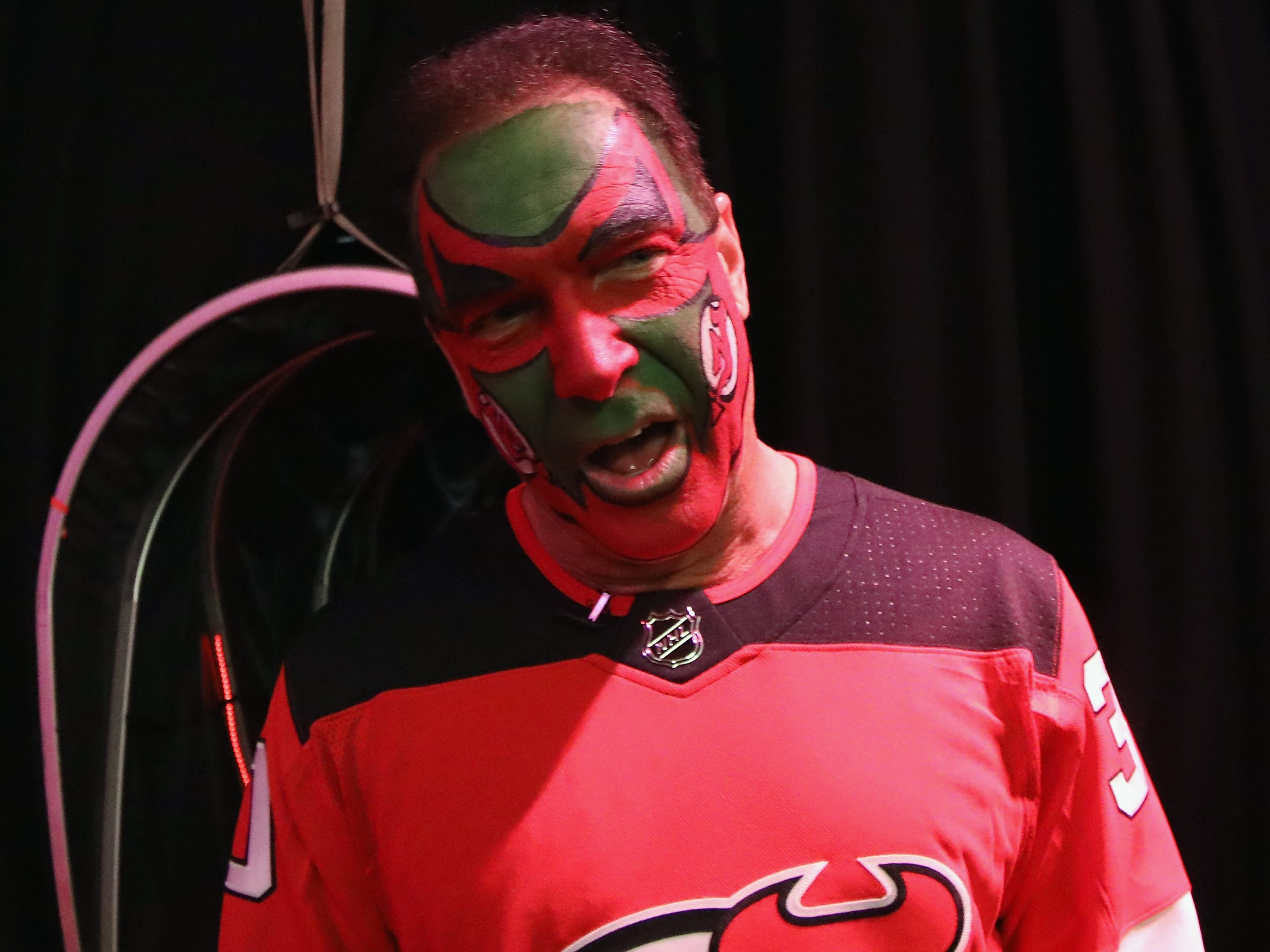 """Patrick Warburton who played the part of David Puddy on the TV show """"Seinfeld"""" arrives for the game between the Pittsburgh Penguins and the New Jersey Devils at the Prudential Center on February 19, 2019 in Newark, New Jersey. The Devils gave out 'Puddy' bobble head dolls before the game."""