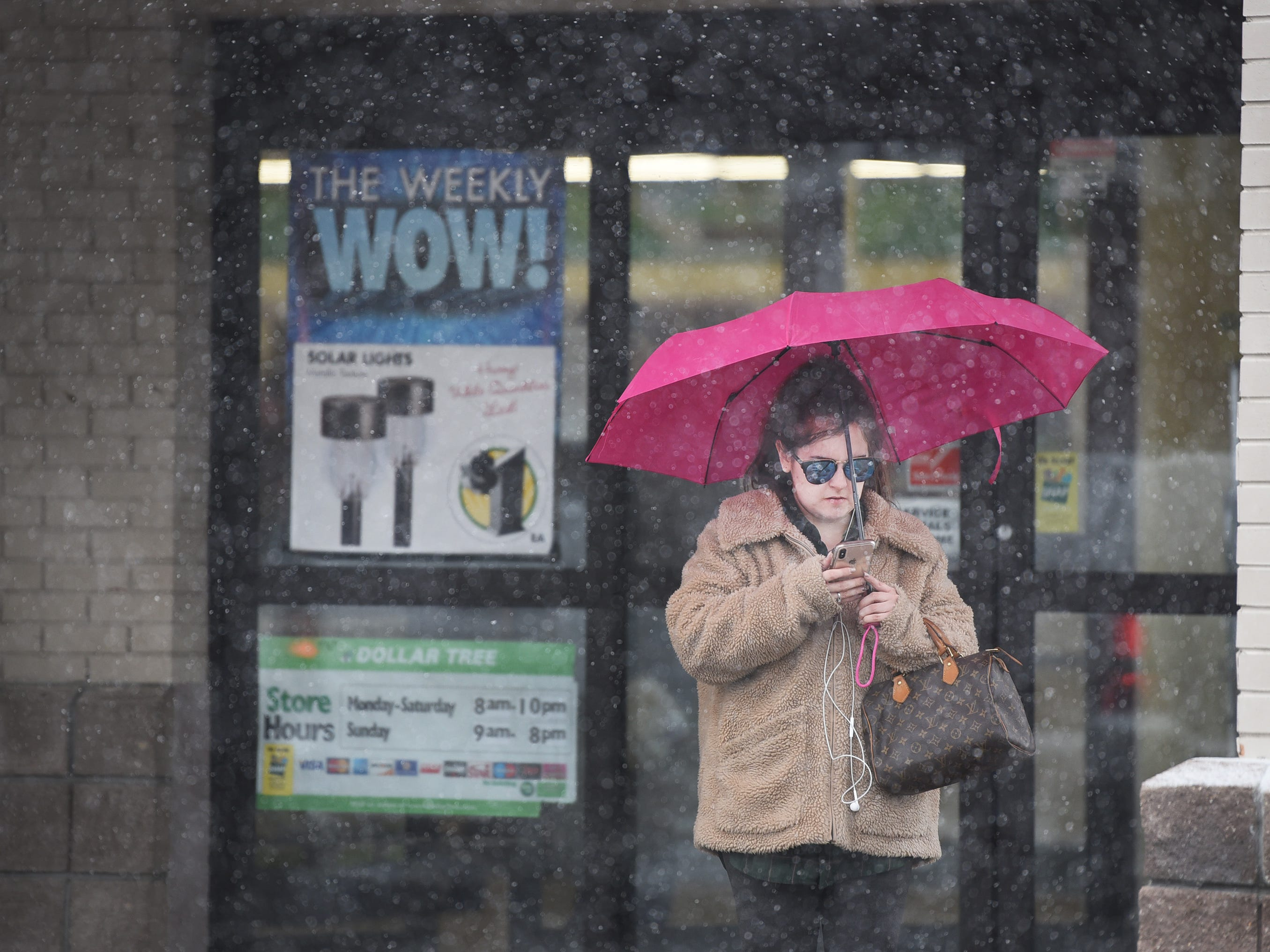 A woman with an umbrella  is seen as the snow falls in Fair Lawn on 02/20/19.