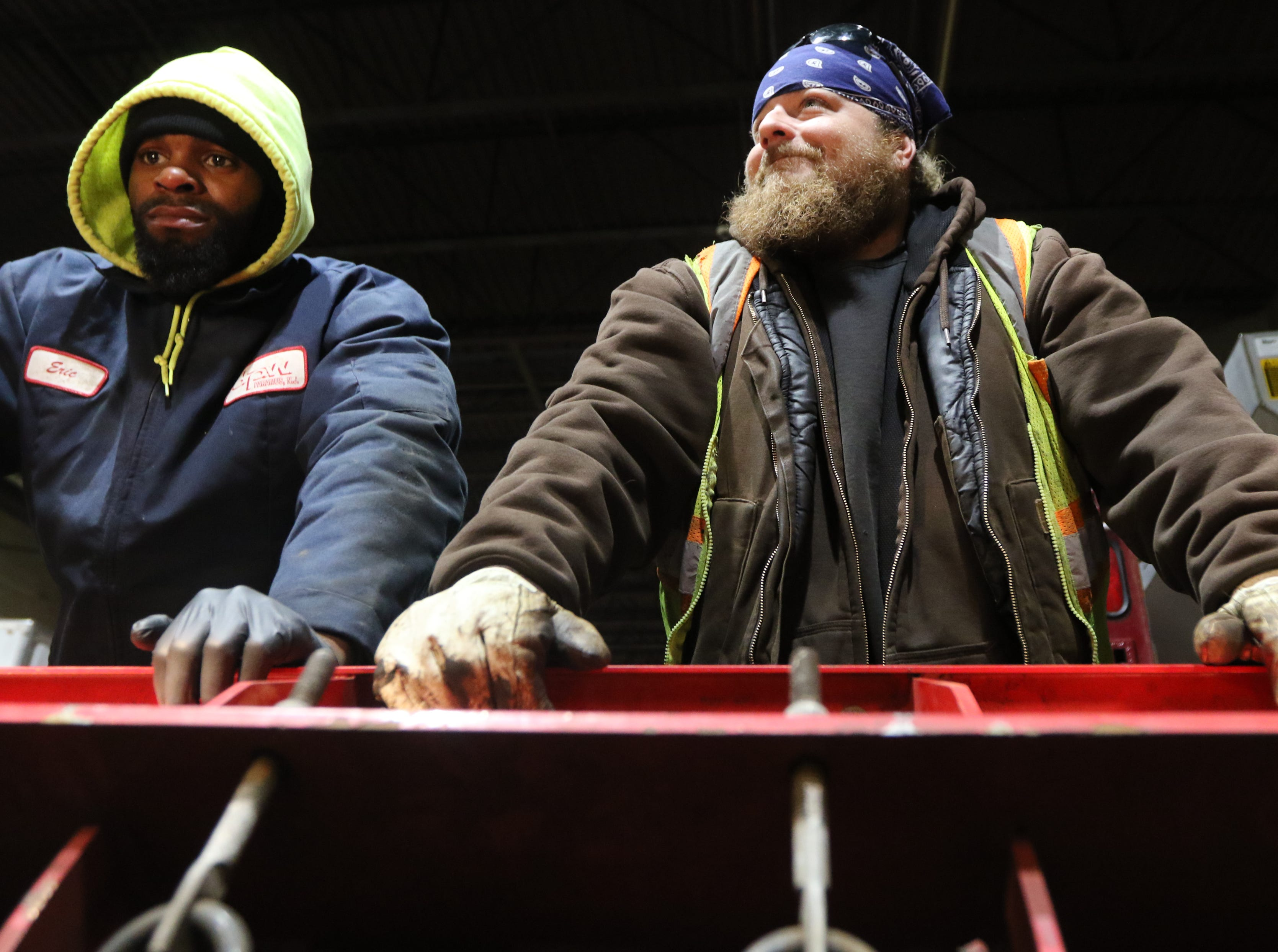 Heavy Equipment Operator, Sean Cullen (right) and Laborer, Eric Braddy, holds onto a plow as it is being repaired at the Paramus Department of Public Works. Wednesday, February 20, 2019.