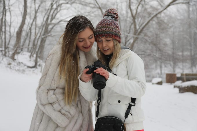 Andrea Doucette and Amanda Aller both of Roxbury look at the images taken as part of their photo shoot in the afternoon snow at Speedwell Park on February 20, 2019.