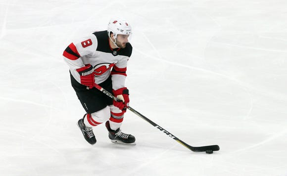New Jersey Devils' Will Butcher skates against the Minnesota Wild in an NHL hockey game Friday, Feb.15, 2019, in St. Paul, Minn. (AP Photo/Jim Mone)