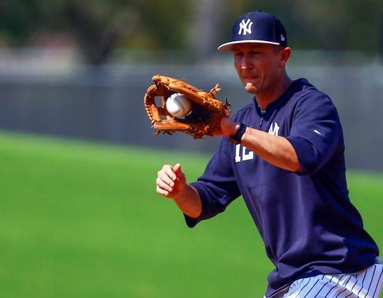 Feb 19, 2019; Tampa, FL, USA; New York Yankees shortstop Troy Tulowitzki catches a throw at second base (12) during spring training at George M. Steinbrenner Field