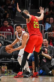 New York Knicks guard John Jenkins (30) is guarded by Atlanta Hawks center Alex Len (25) during the second half at State Farm Arena.