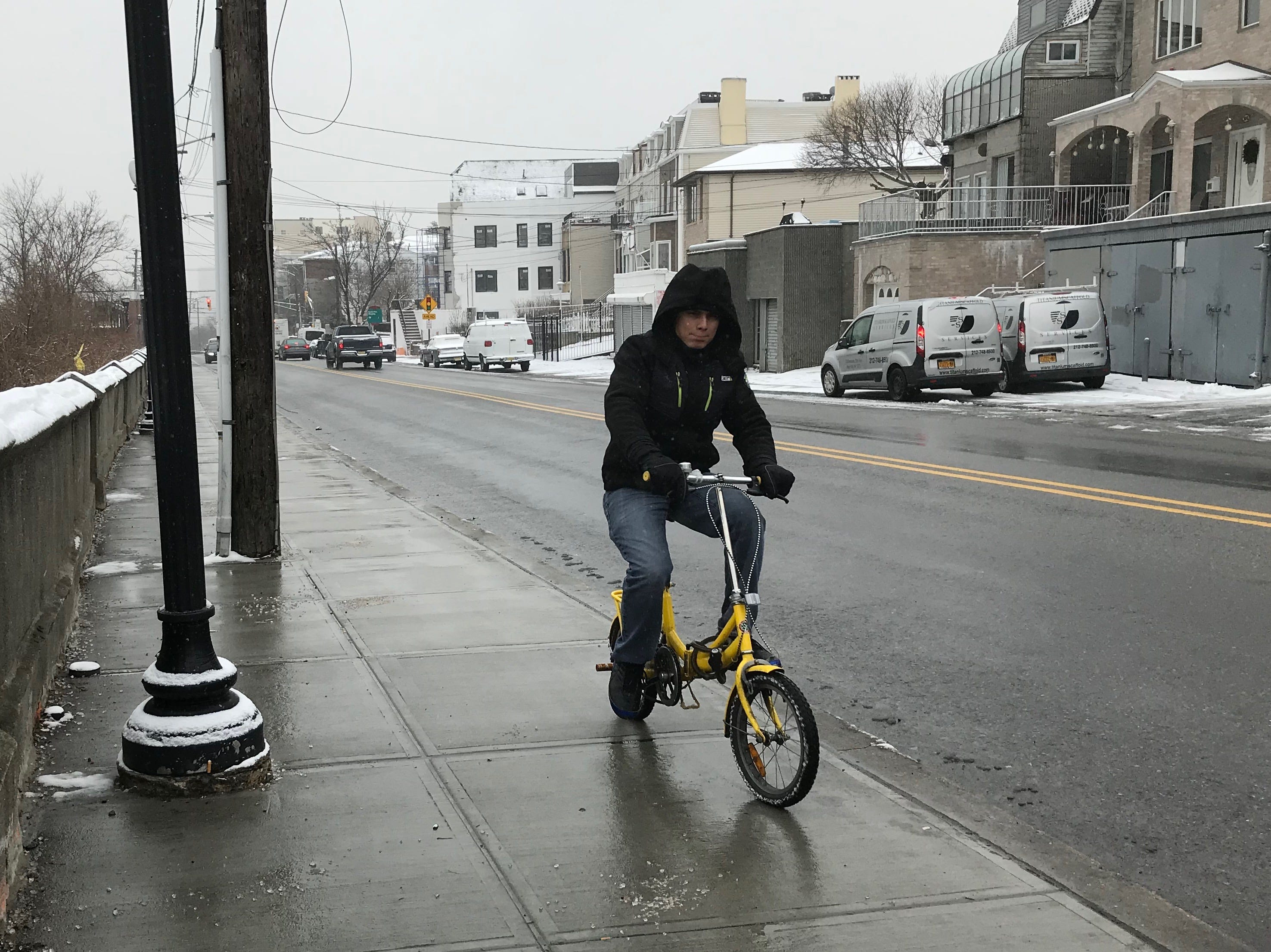 By 2 p.m. snow was falling steadily in Hudson County but not sticking to treated sidewalks and streets. It allowed this bike rider to traverse Jersey City with ease.