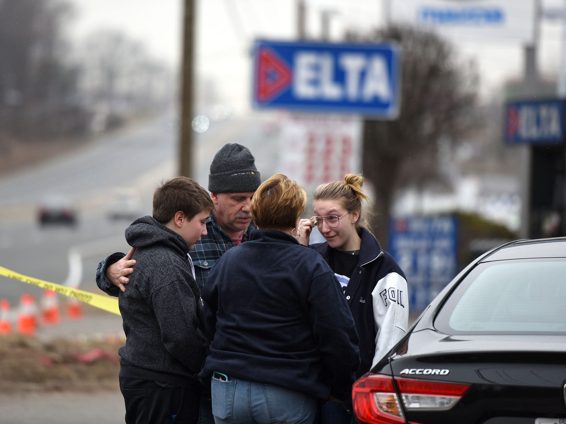 Mourners came to the Delta Station on Rt. 23 in Wayne on Wednesday, February 20, 2019 where Jon and Luke Warbeck and Lovedeep Fatra died when a car crashed into the Delta station on Tuesday.