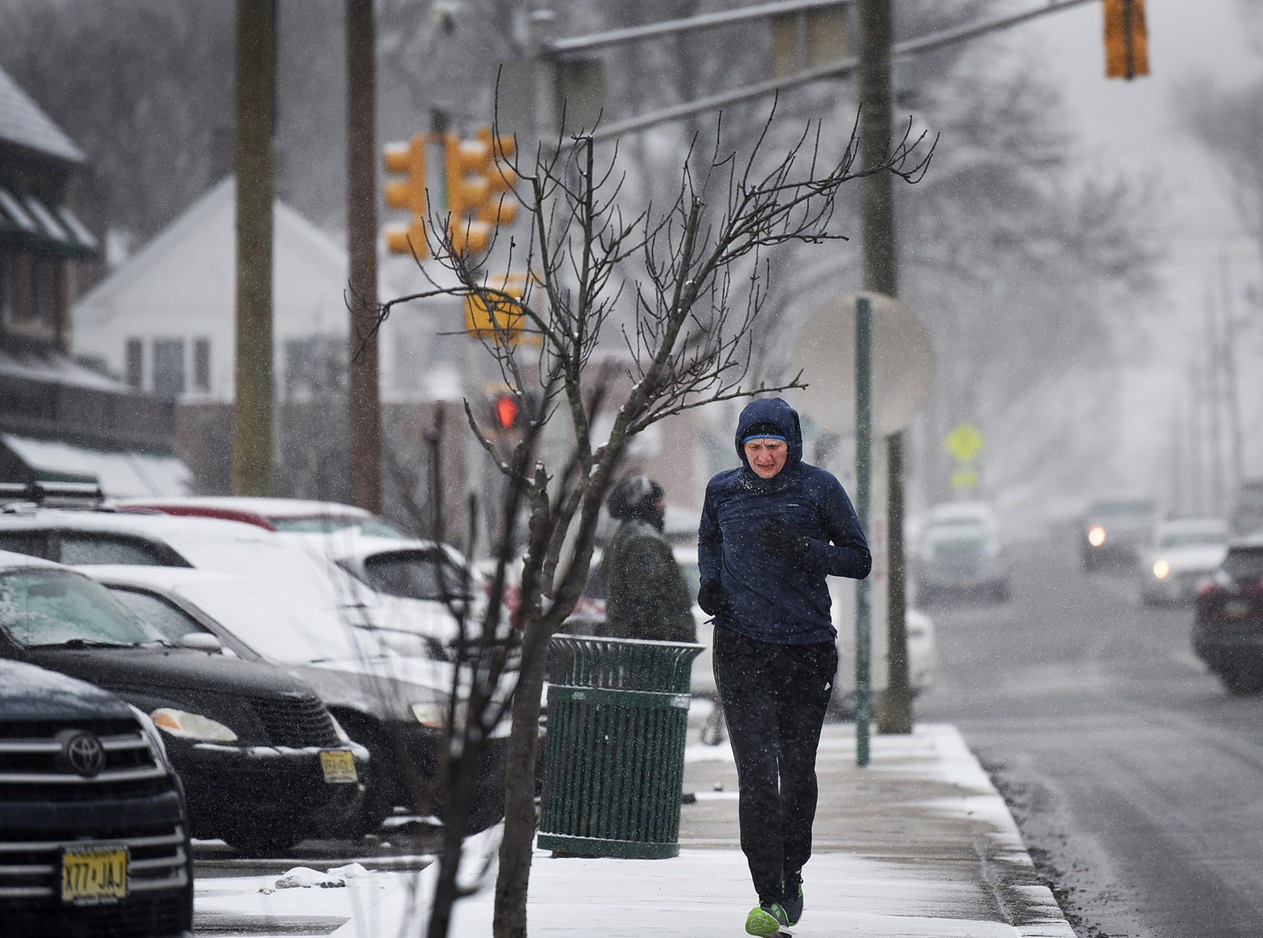 A man jogs along Fair Lawn Avenue as the snow falls in Fair Lawn on 02/20/19.